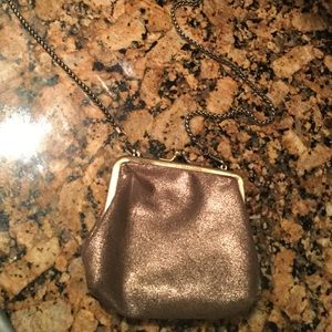 Cross body small bronze colored purse